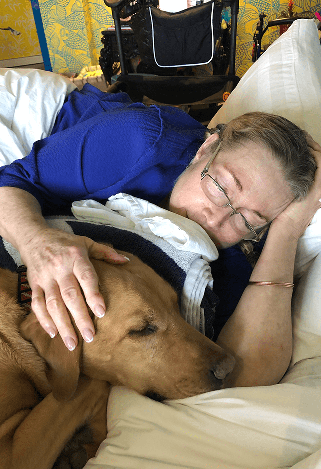 a lady and dog sleeping together