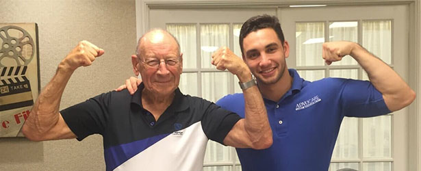 two man showing there biceps